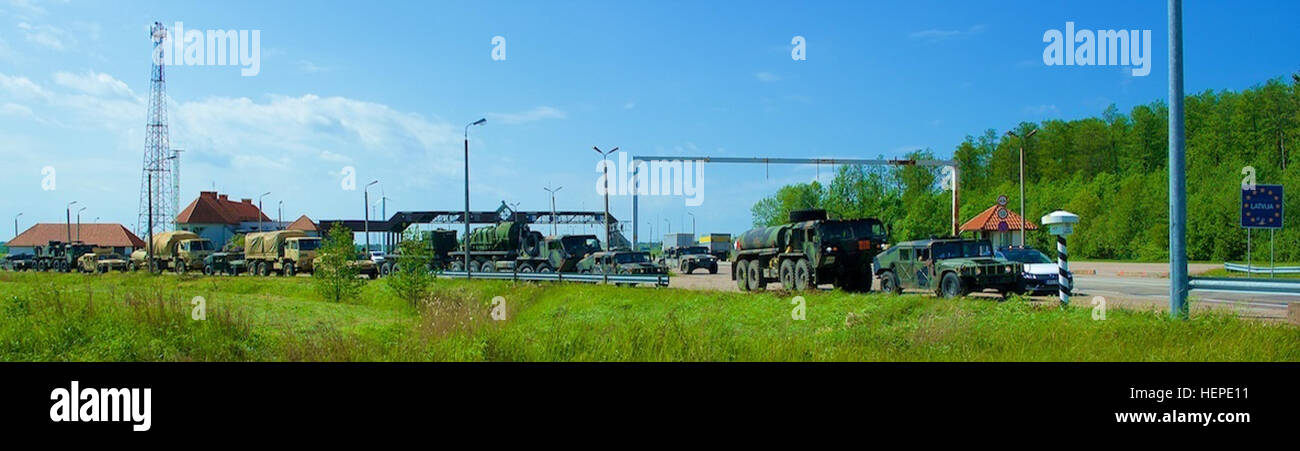 A convoy of wheeled vehicles from 2nd Battalion, 7th Infantry Regiment, 1st Armored Brigade Combat Team, 3rd Infantry Stock Photo