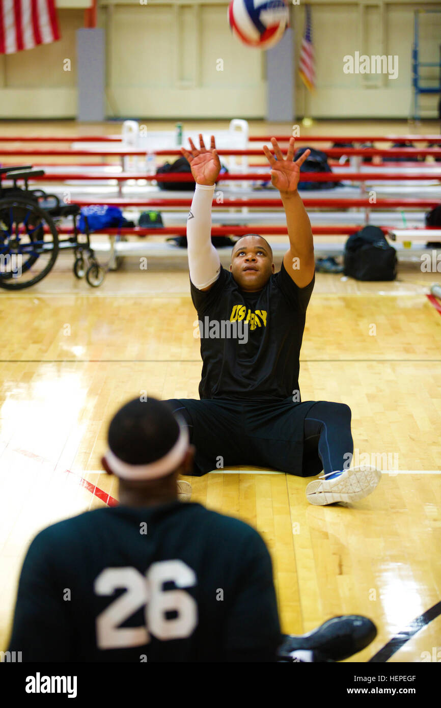 U.S. Army National Guard Staff Sgt. Robert Green, from San Antonio, Texas, receives a pass during sitting volleyball - Stock Image