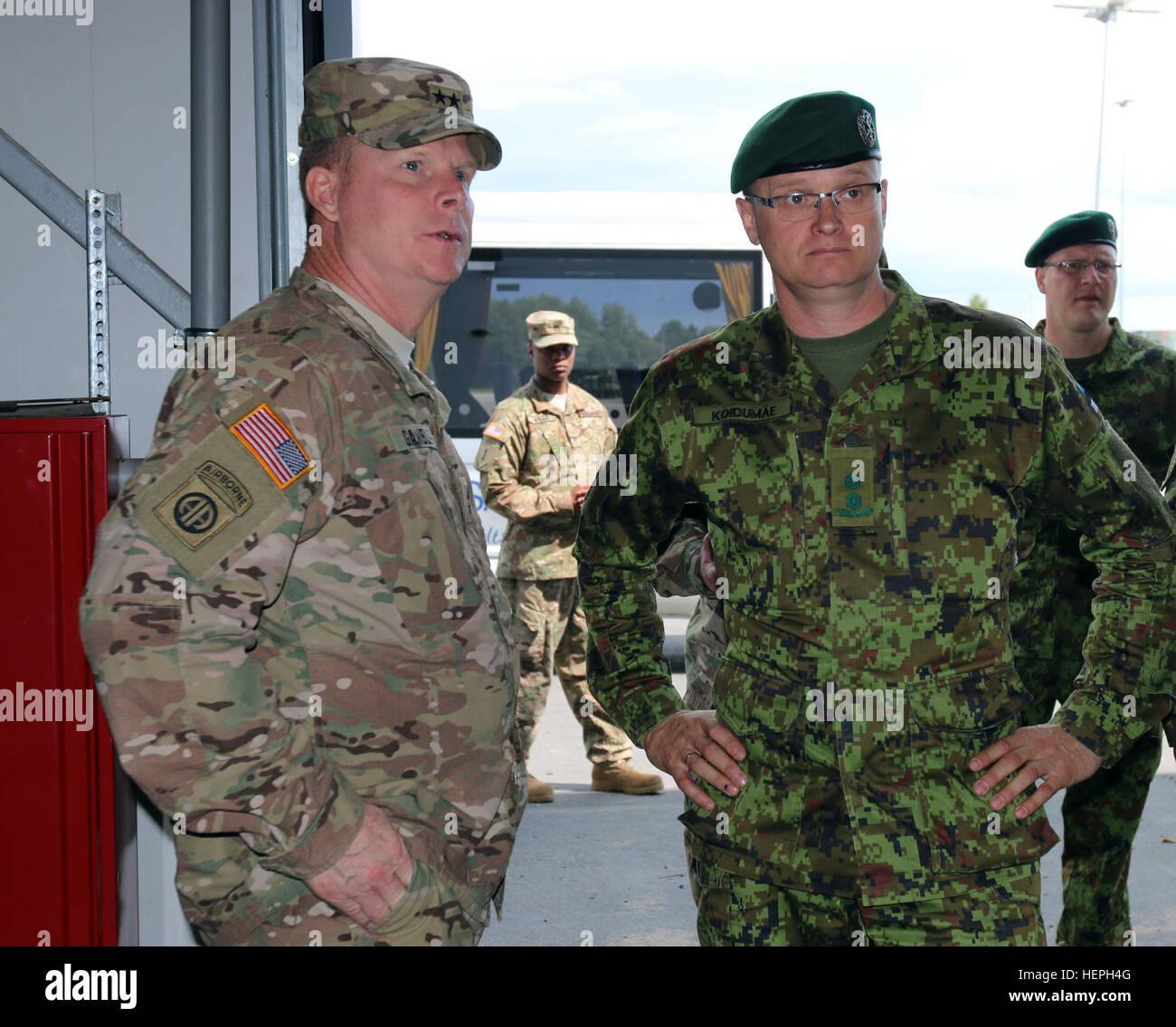 Maj. Gen. Duane A. Gamble, commander, 21st Theater Sustainment Command since June 24, 2015, speaks with Estonian - Stock Image