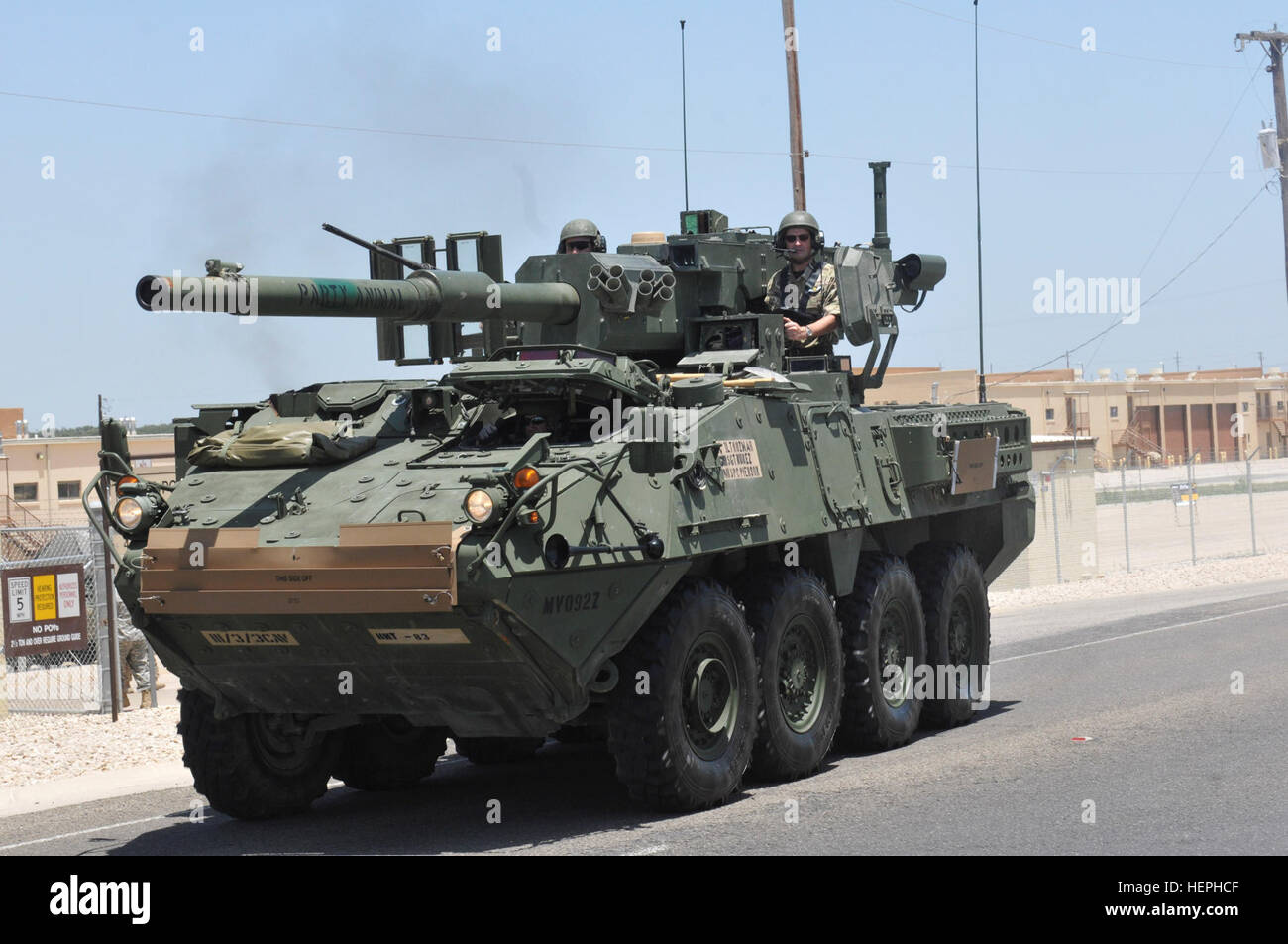 British Brig. Gen. James Illingsworth sits out of the truck commander's hatch of the M1128 Mobile Gun System Stryker - Stock Image