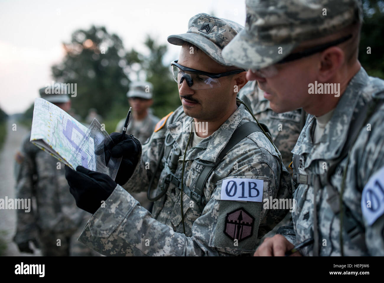 https://c8.alamy.com/comp/HEPJW6/sgt-christian-r-sanchez-reviews-grid-coordinates-with-sgt-brett-carpenter-HEPJW6.jpg