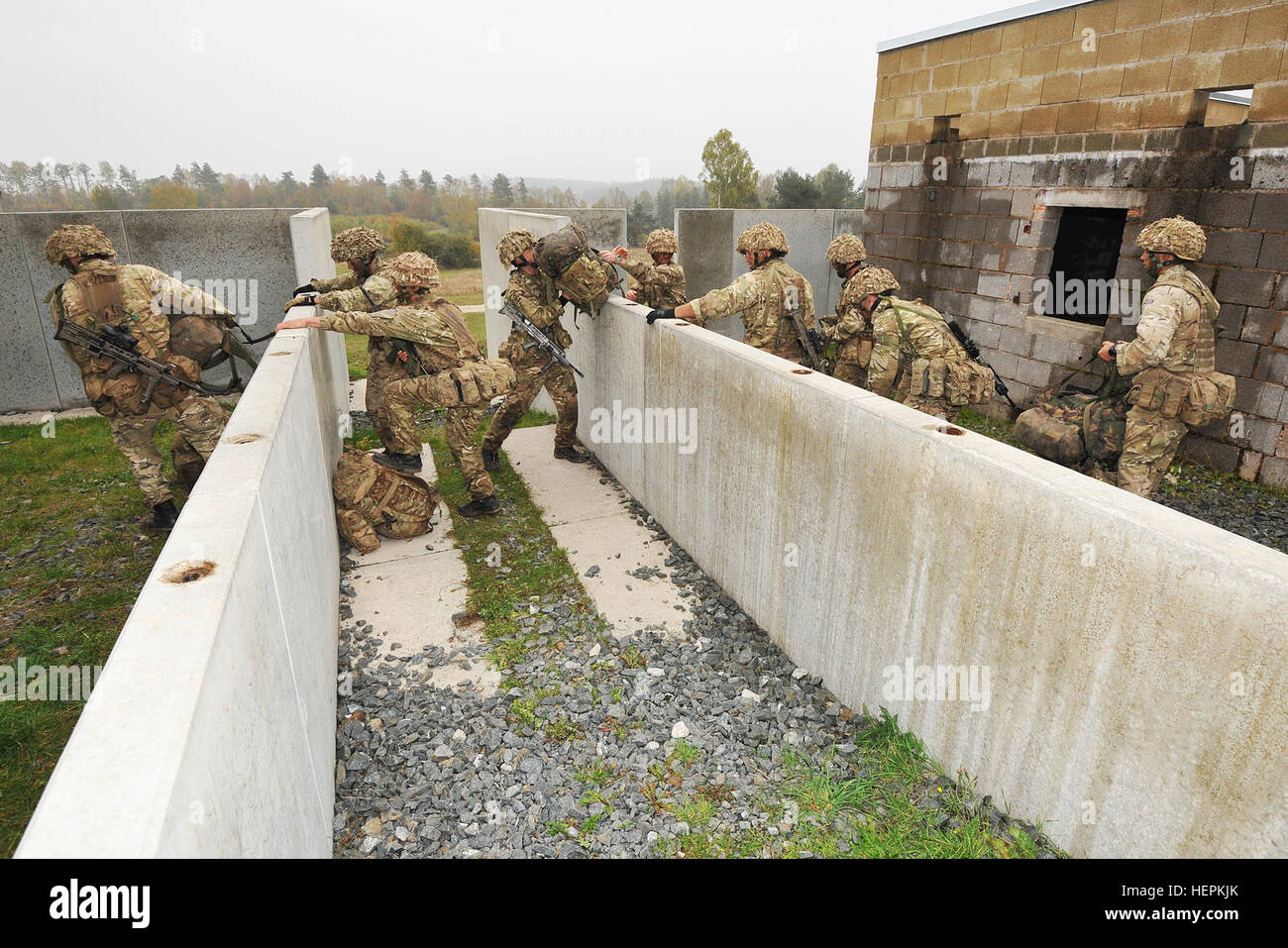 Royal British soldiers conduct the Urban Casualty Evacuation lane during the European Best Squad Competition at - Stock Image