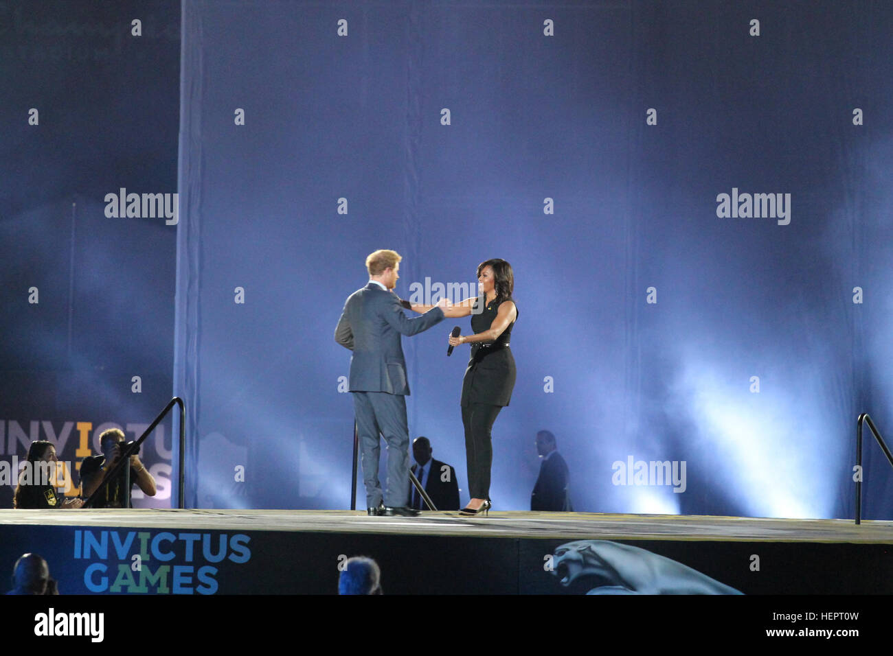 Prince Harry And First Lady Michelle Obama Exchange Greetings During