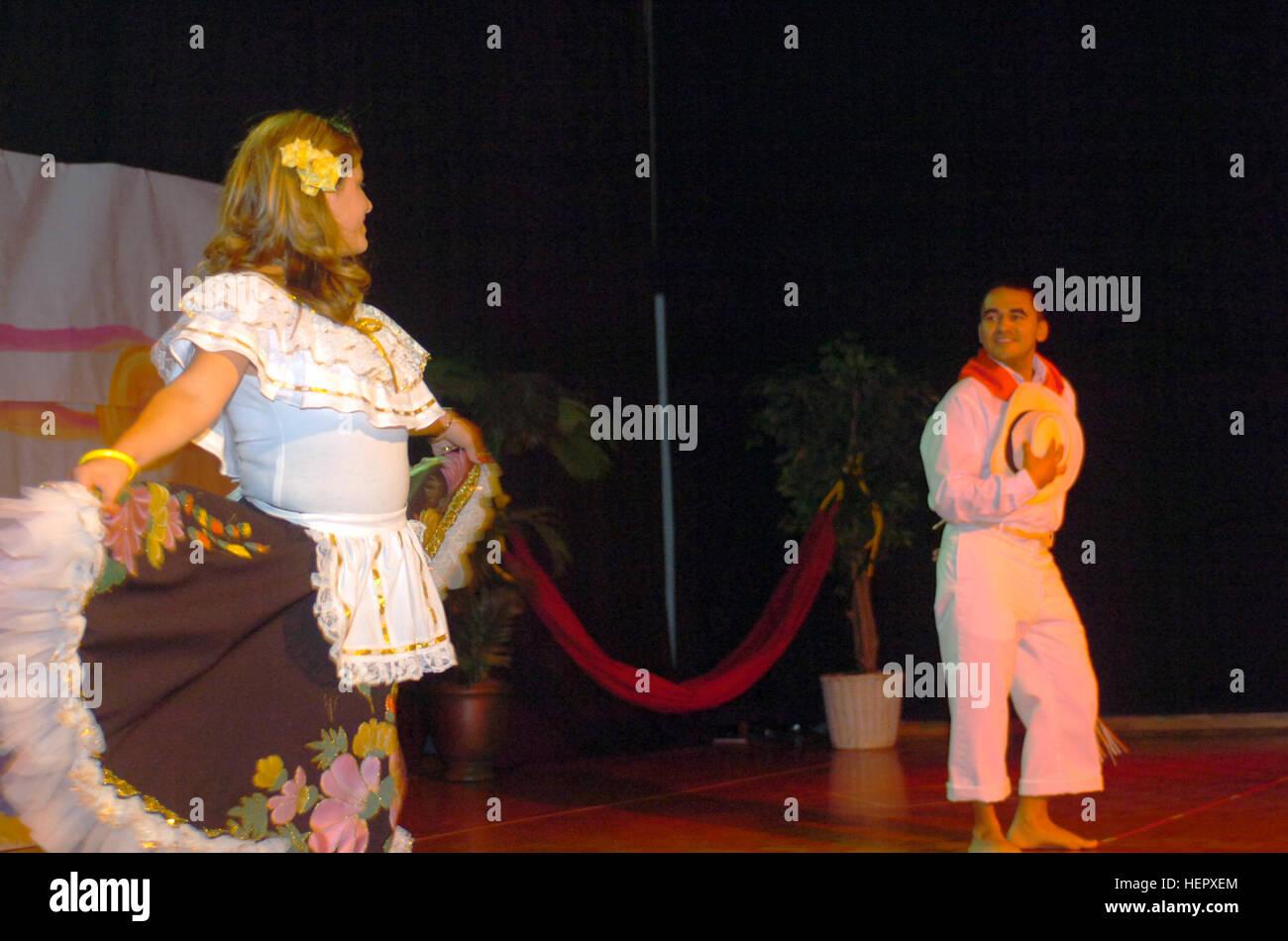 GUANTANAMO BAY, Cuba – Marysol Restrepo and Jorge Restrepo perform the Cumbia, a native Columbian dance, at U.S. - Stock Image