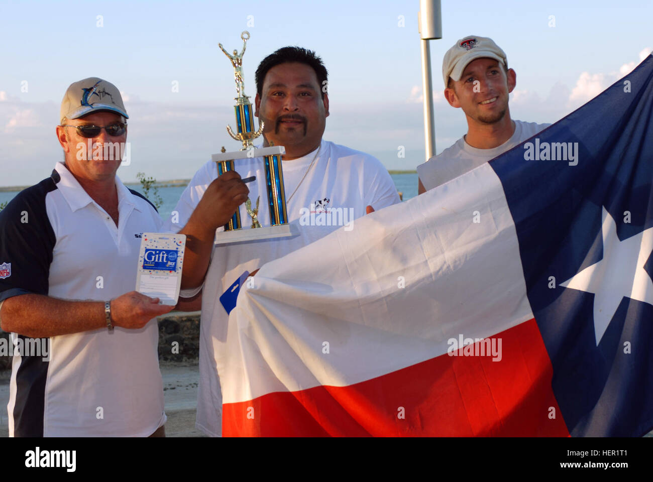 David Manzano (center) and William Abrahams (right) are presented a trophy by U.S. Naval Station Guantanamo Bay's - Stock Image