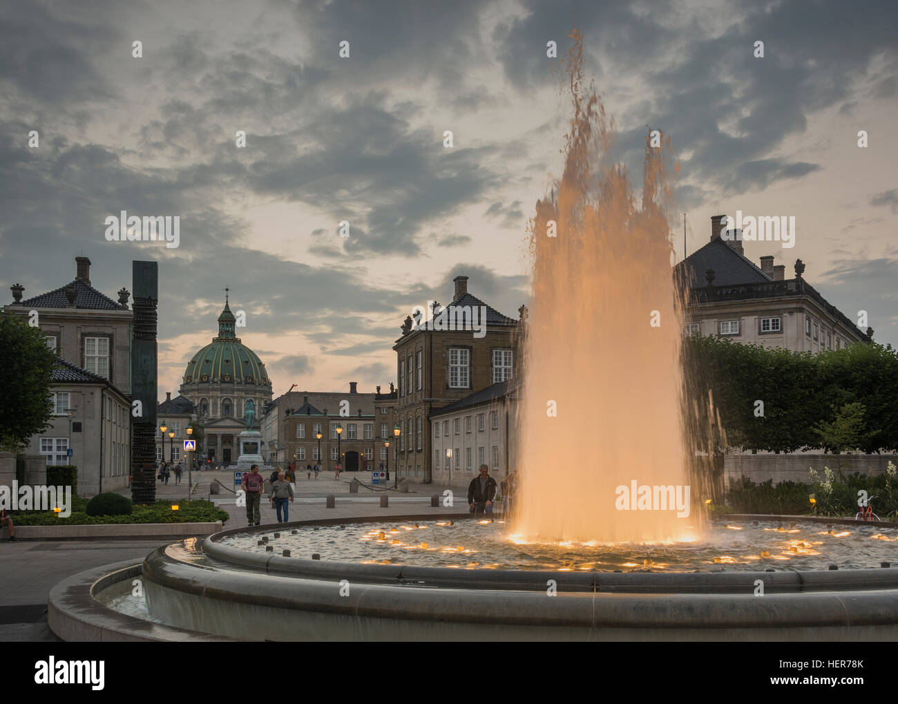 The fountains lit up at night at the Amalienborg in Copenhagen - Stock Image