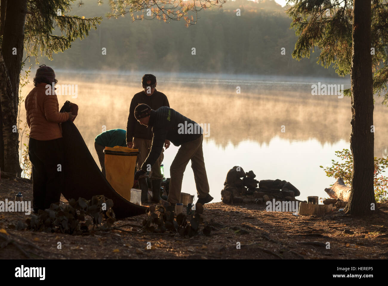 Packing up camp on a canoe trip in the St. Regis Canoe Area of Adirondack State Park, New York. - Stock Image