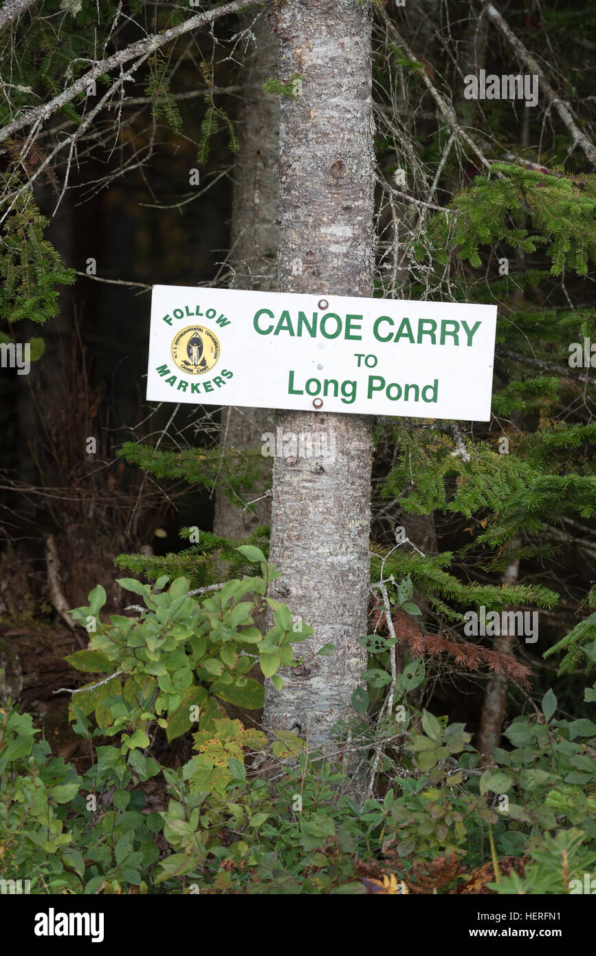 Canoe carry sign in the St. Regis Canoe Area of Adirondack State Park, New York. - Stock Image