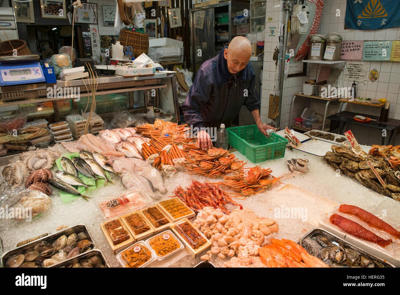 Seafood seller in Nishiki Market, Kyoto, Japan - Stock Image