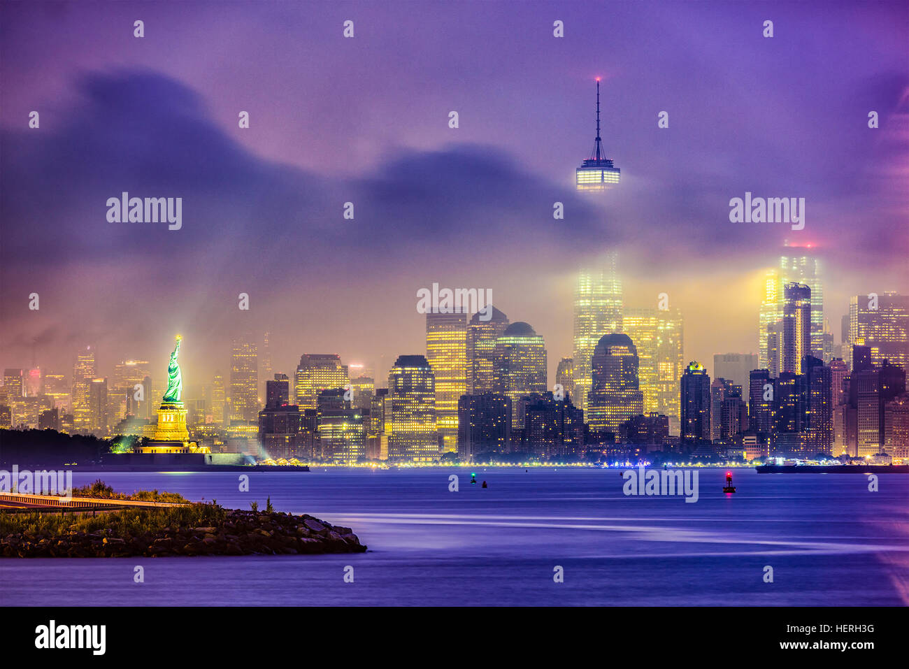 New York City skyline on a foggy night. - Stock Image