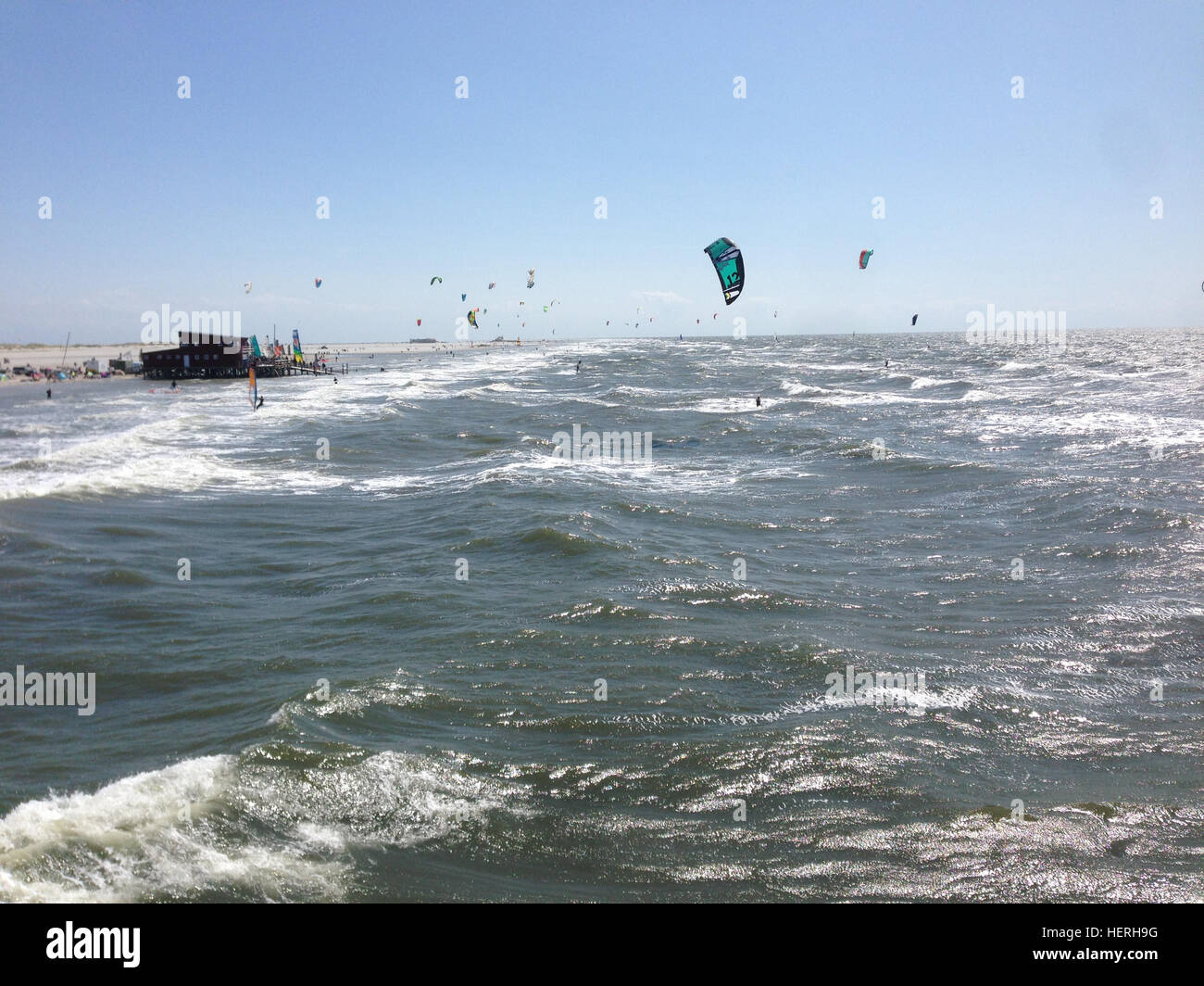kite surfing is a famous sport in st peter ording germany stock photo 129596252 alamy. Black Bedroom Furniture Sets. Home Design Ideas