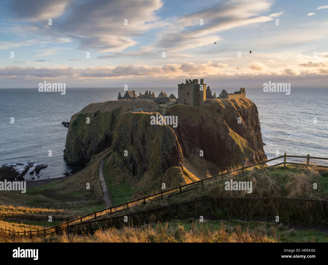 Dunnottar Castle near Aberdeen in North East Scotland is a ruined cliff top fortress  on a rocky outcrop just off - Stock Image