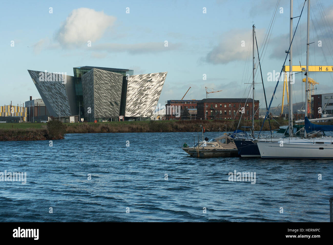 View across Belfast Harbor showing the iconic Titanic building built as part of the redevelopment of the harbor - Stock Image