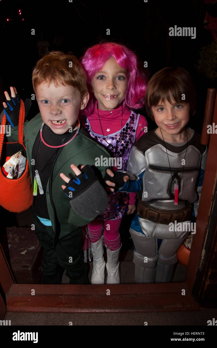 A visit at my front door from galactic Halloween outer space travelers as costumed trick or treaters. St Paul Minnesota - Stock Image