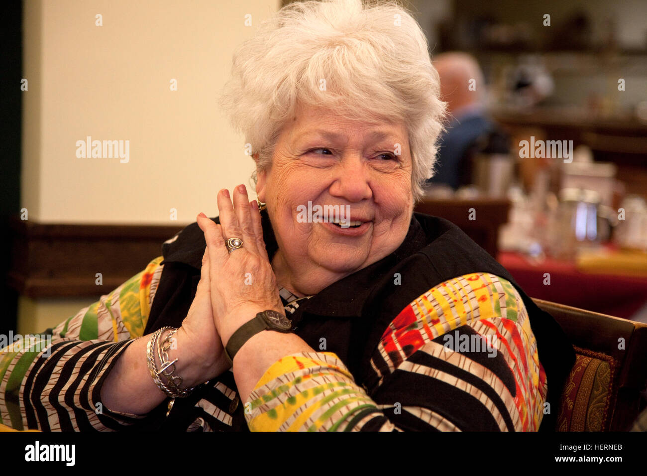 Attractive senior woman having a happy moment at a dinner party. Downers Grove Illinois IL USA - Stock Image