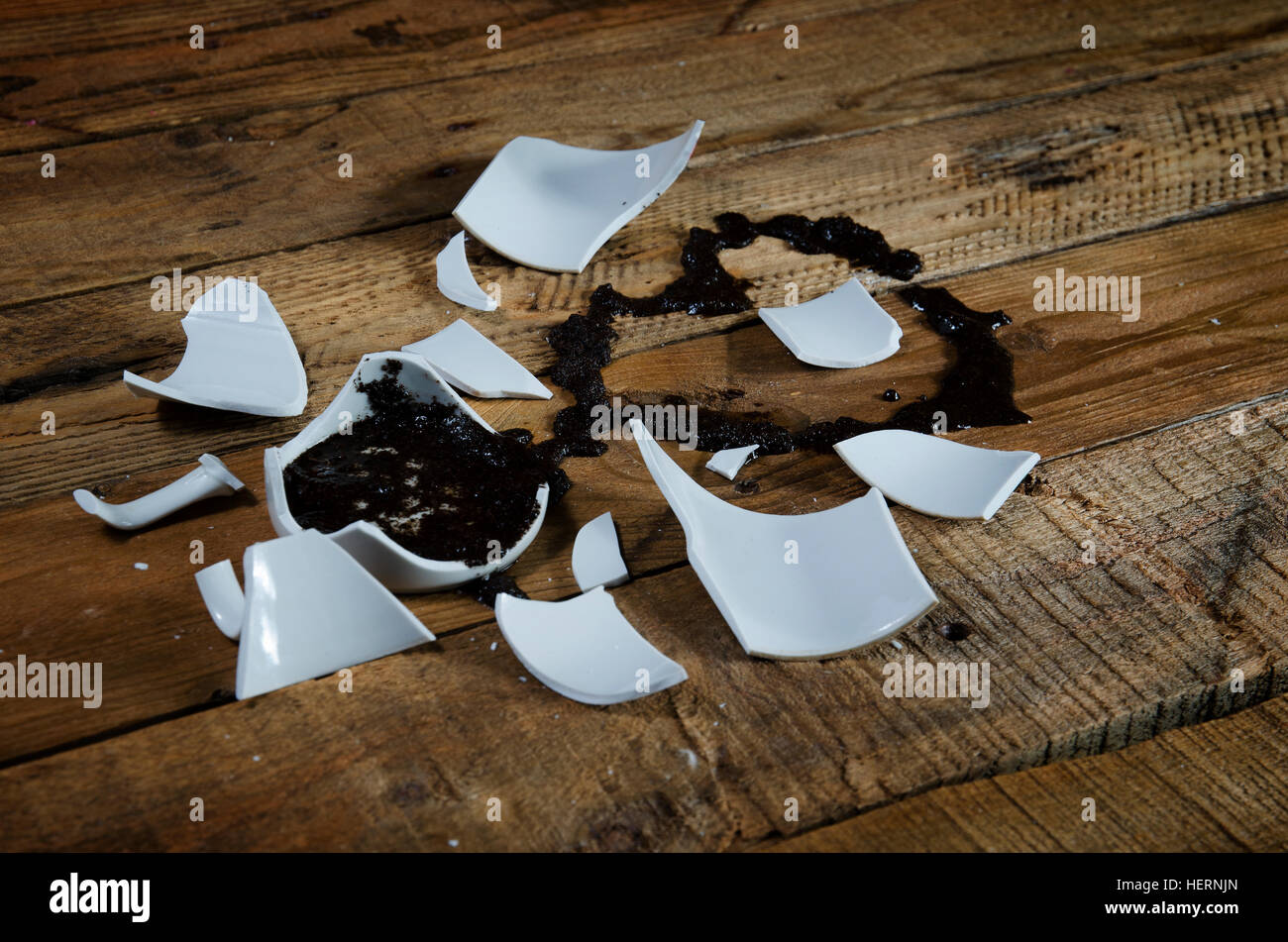 Guessing at love by coffee grounds from the broken cup. - Stock Image