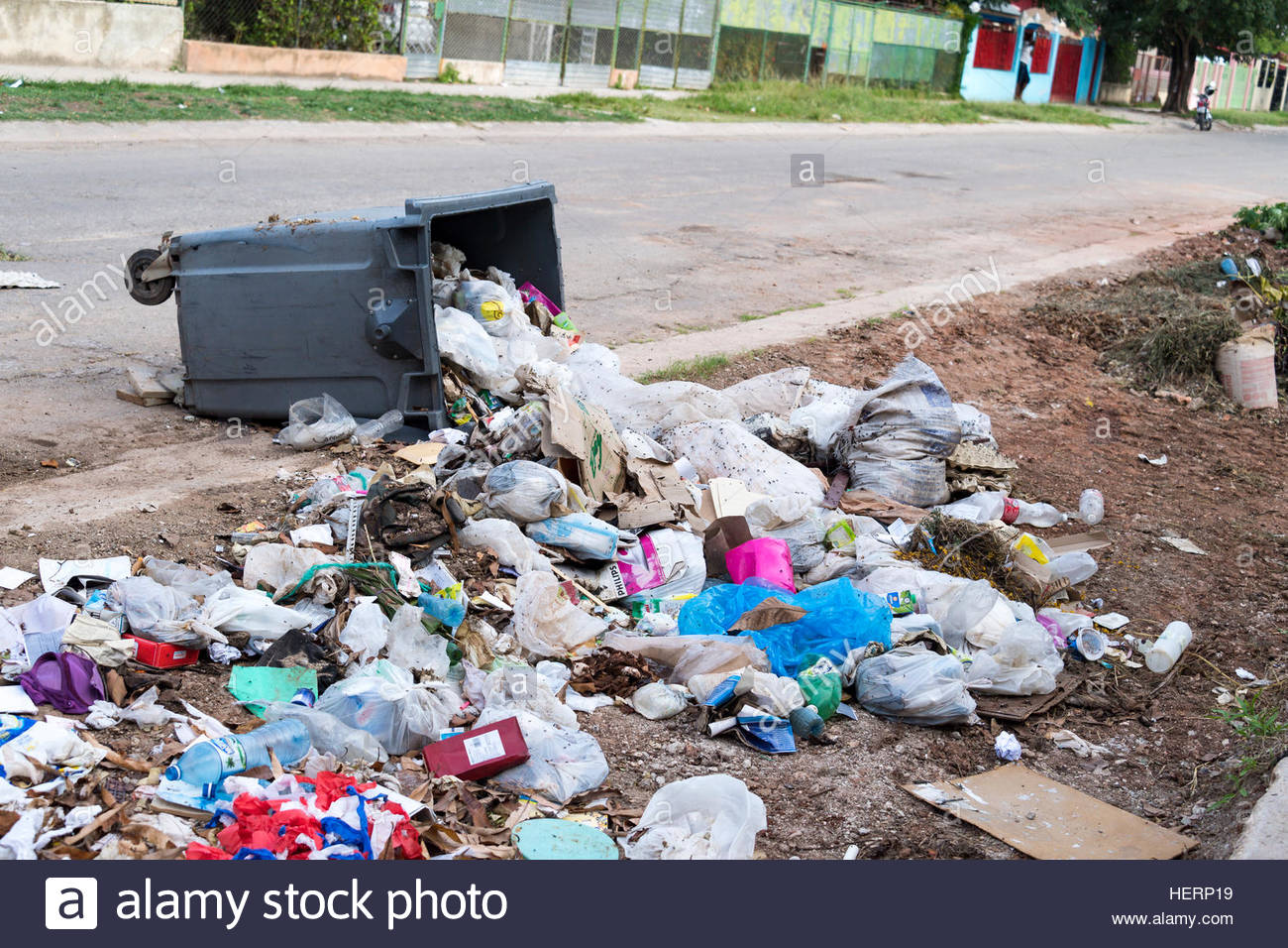 Urban unhealthy condition of Improperly disposed litter waste on street. - Stock Image