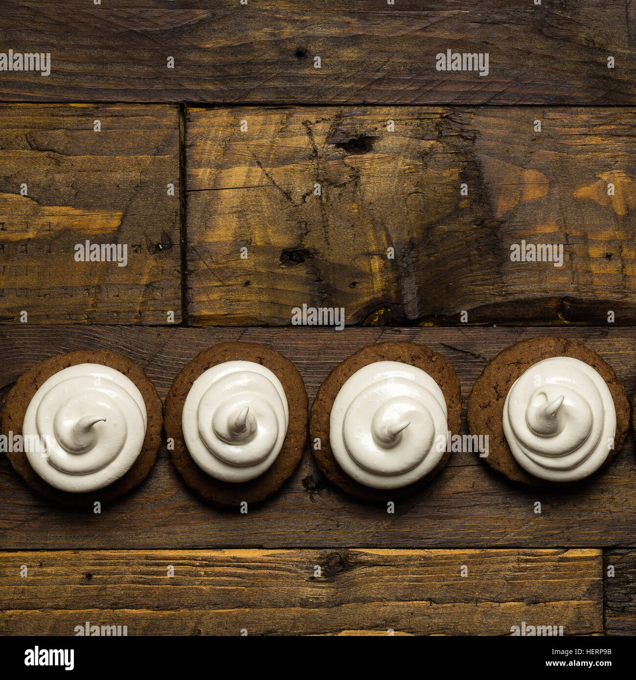 Hot chocolate cookies with marshmallow meringue on dark brown rustic wood background Stock Photo