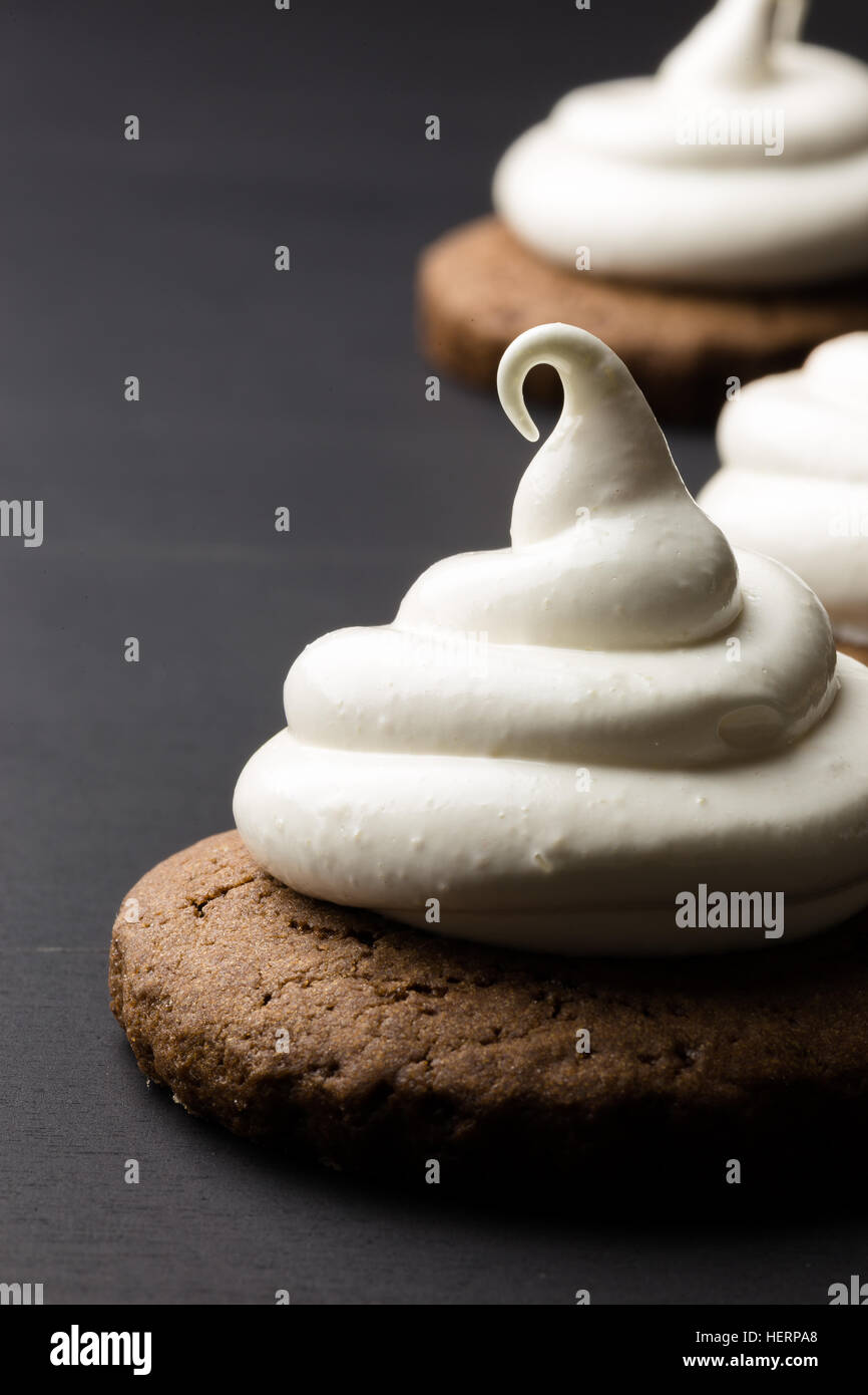 Hot chocolate cookies with marshmallow meringue on blackboard  background - Stock Image