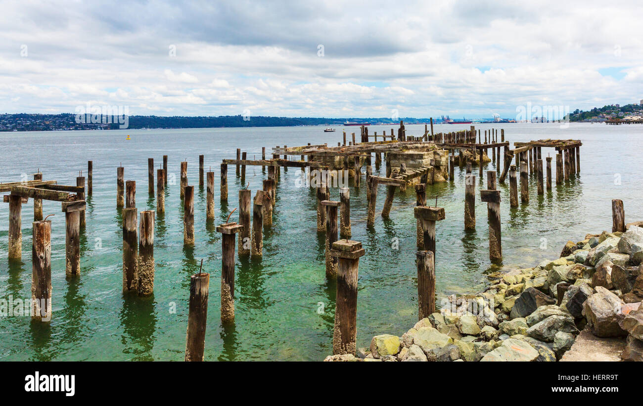 Ruins of old industrial activity on Commencement Bay, Tacoma, WA - Stock Image