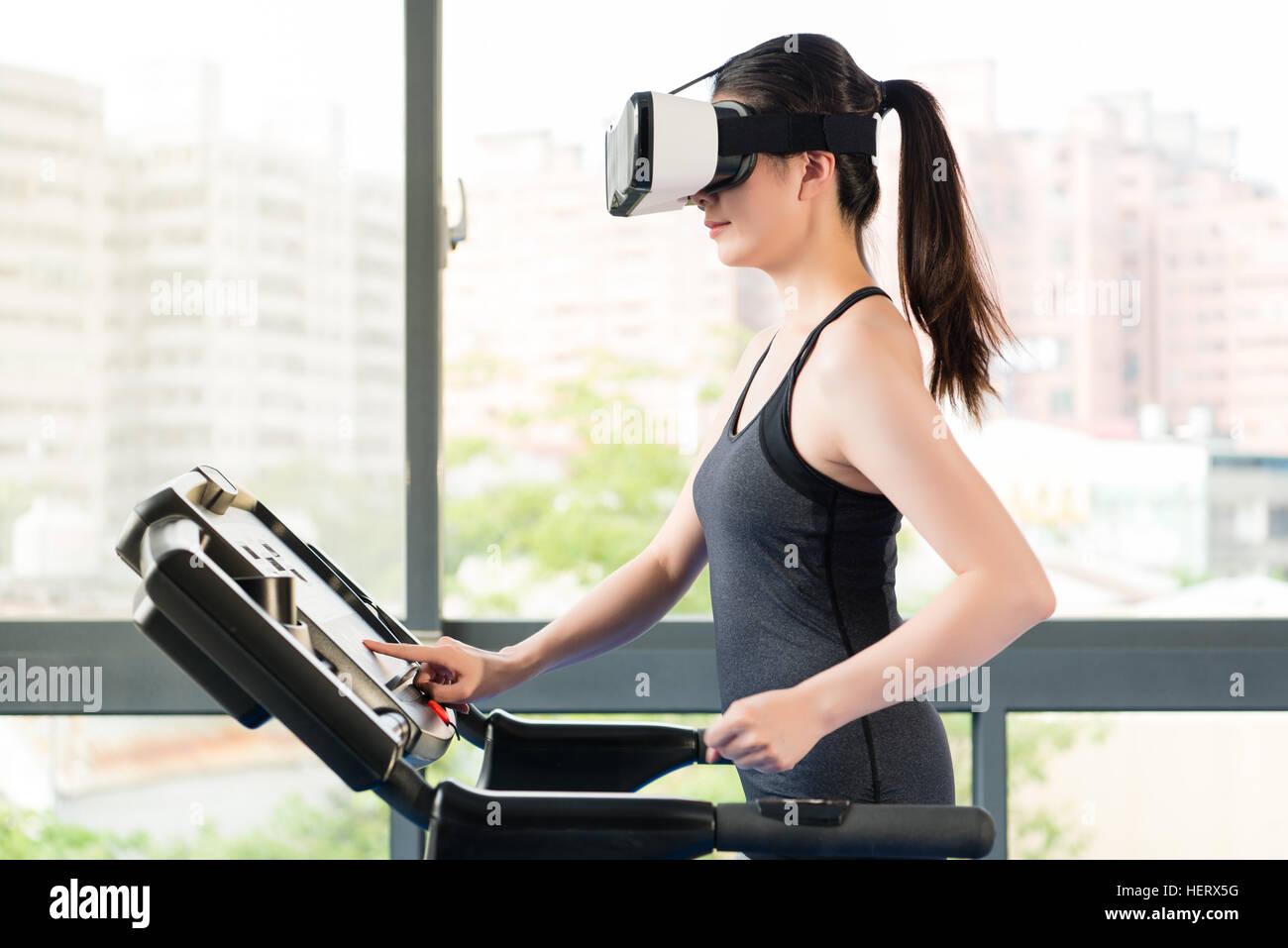 Beauty Asian Woman Running Treadmill By Virtual Reality