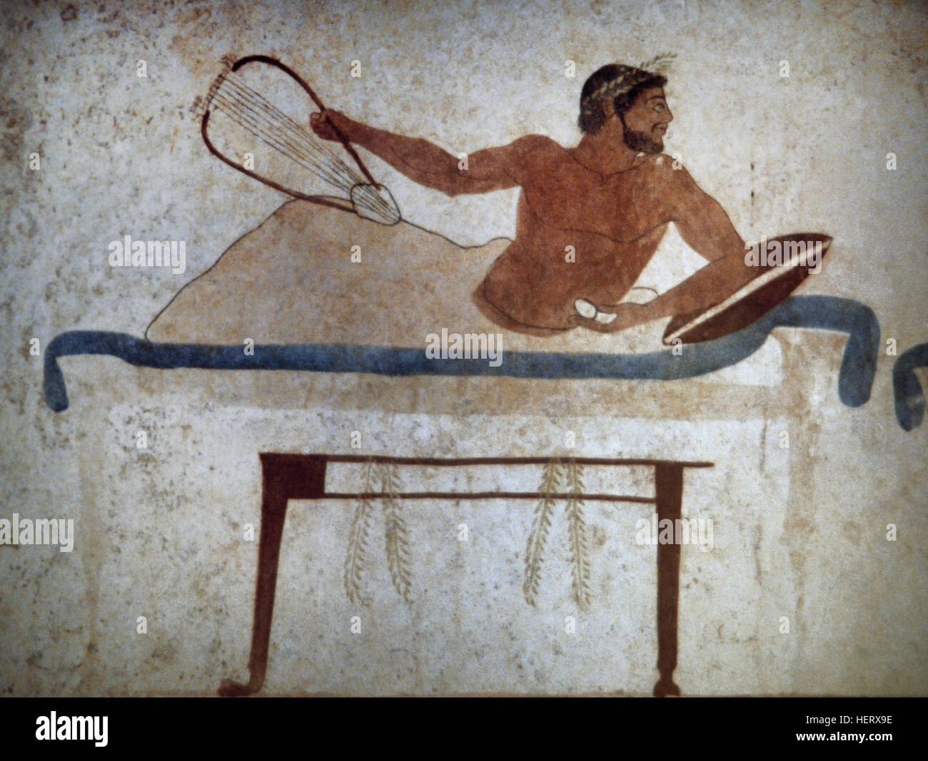 Tomb of the Diver. 470 BC. Fresco depicting a Symposium scene. Detail. Paestum National Archaeological Museum. Italy. - Stock Image