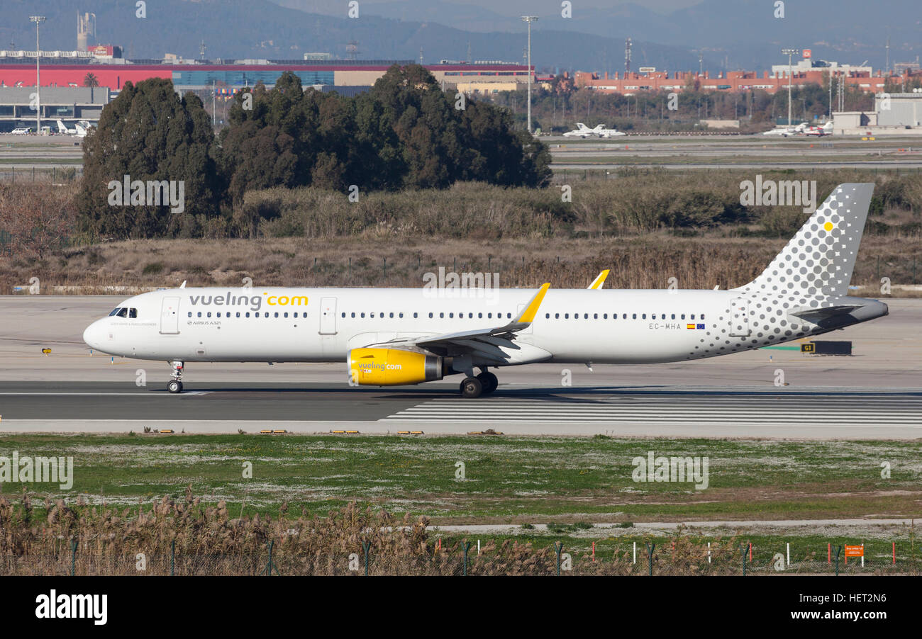 Vueling Airbus A321 taxiing along the runway at El Prat Airport in Barcelona, Spain. - Stock Image