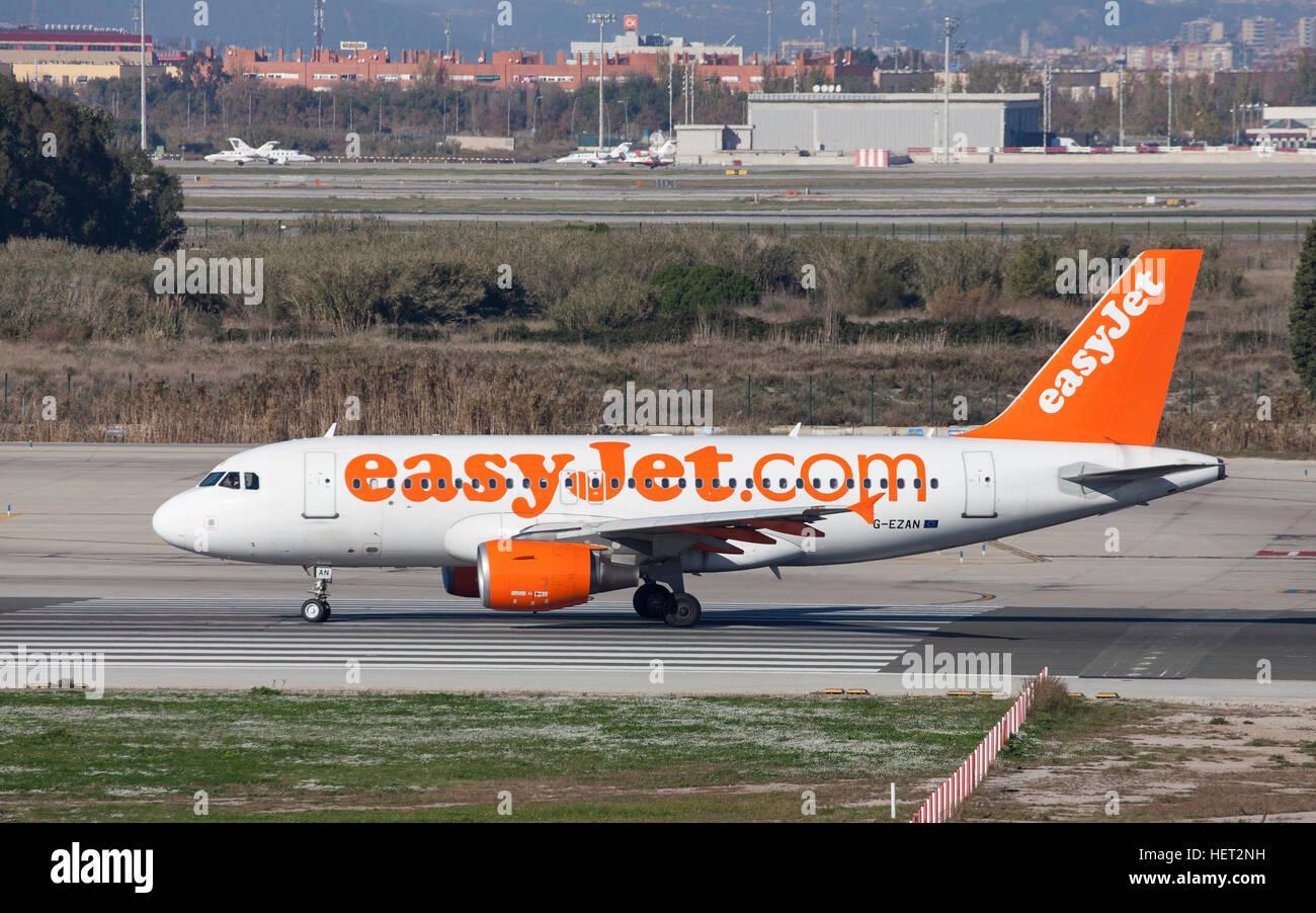 Easyjet Airbus A319 taxiing along the runway at El Prat Airport in Barcelona, Spain. - Stock Image
