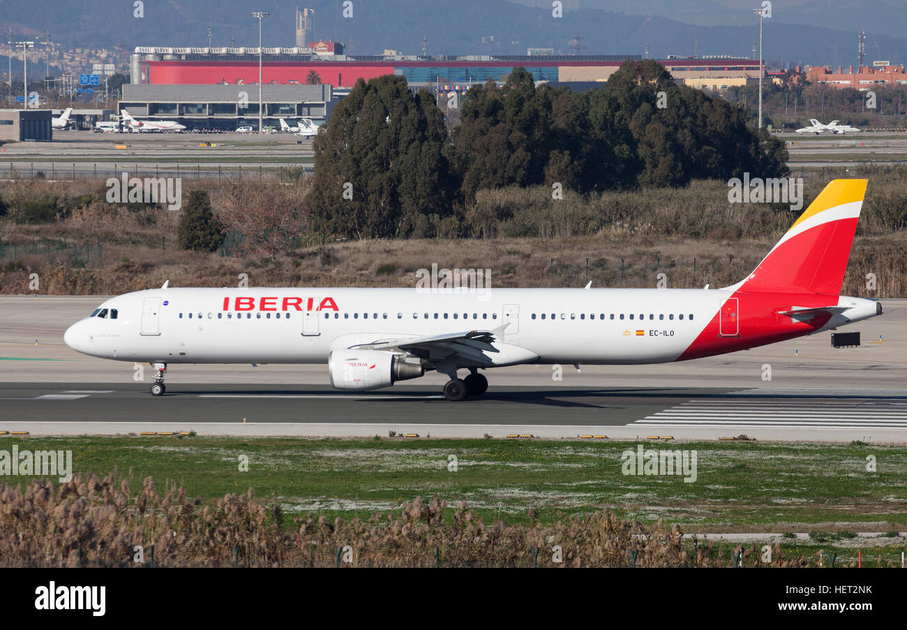Iberia Airbus A321 taxiing along the runway at El Prat Airport in Barcelona, Spain. - Stock Image