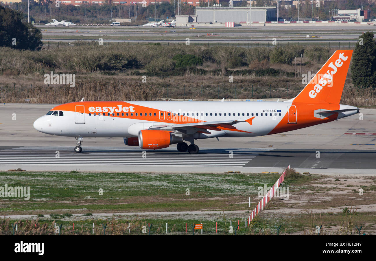 Easyjet Airbus A320 taxiing along the runway at El Prat Airport in Barcelona, Spain. - Stock Image