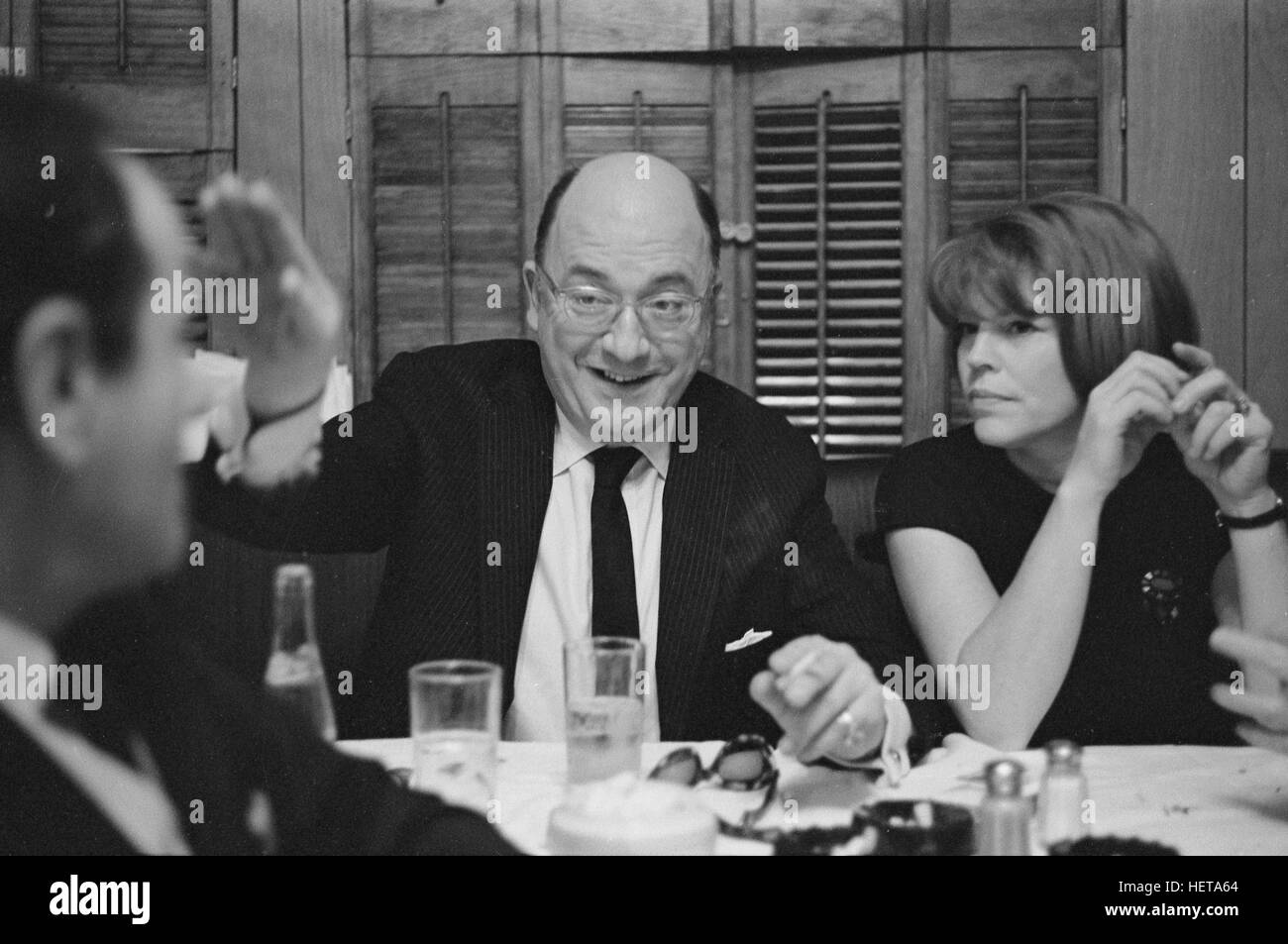 Abe Burrows, dining with the cast of the 1966 play Cactus Flower. Anne Jackson is on the right. - Stock Image