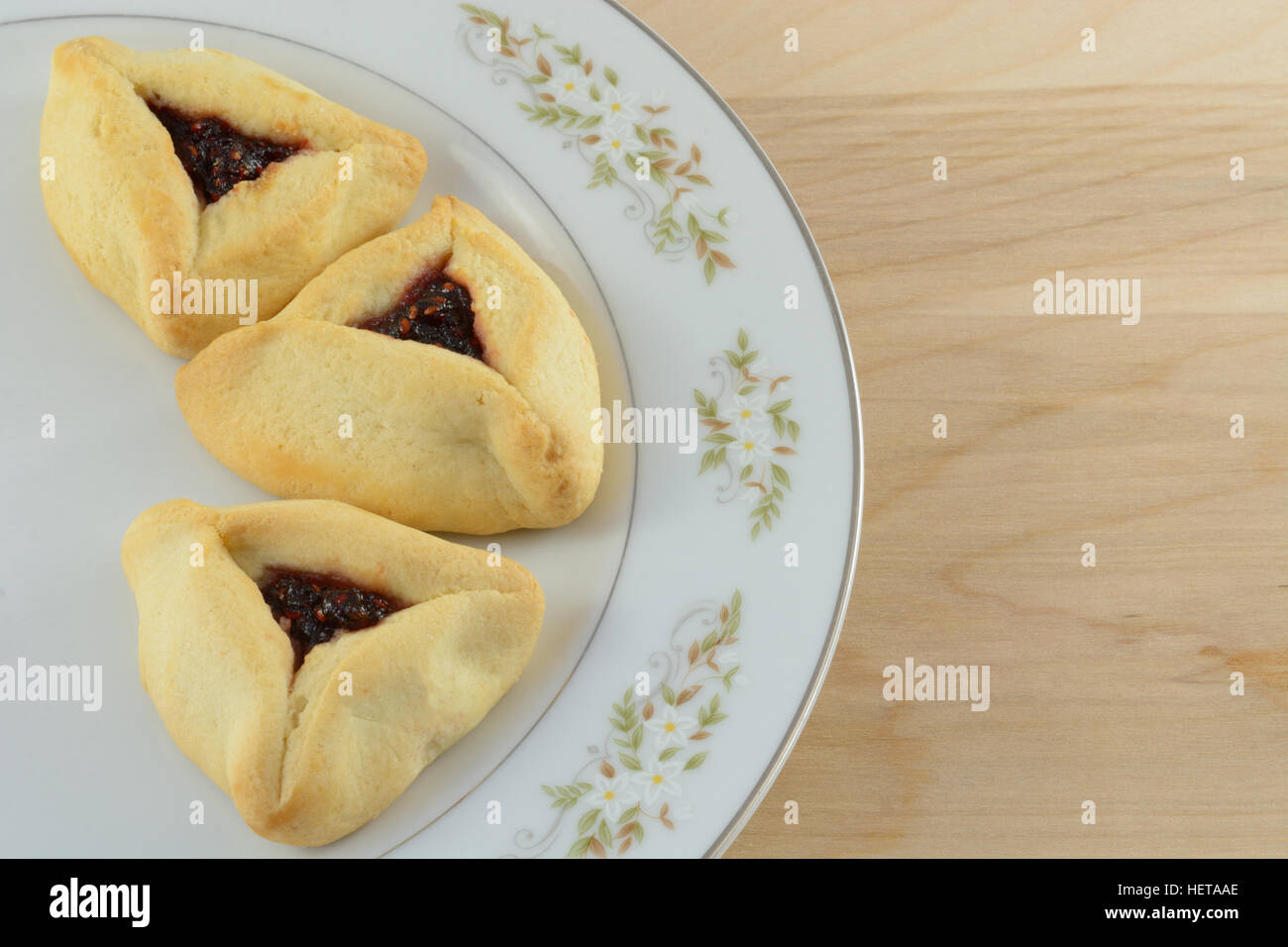 Hamantaschen, pastries on white plate - Stock Image