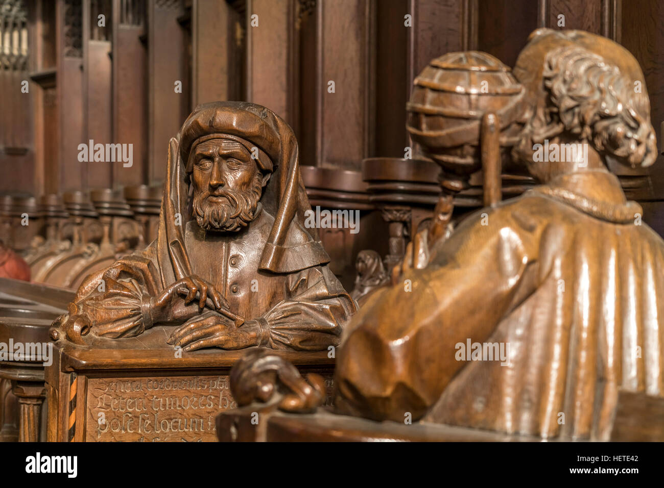 choir stalls with carved busts,  Ulm Minster interior, Ulm, Baden-Württemberg, Germany, Europe - Stock Image