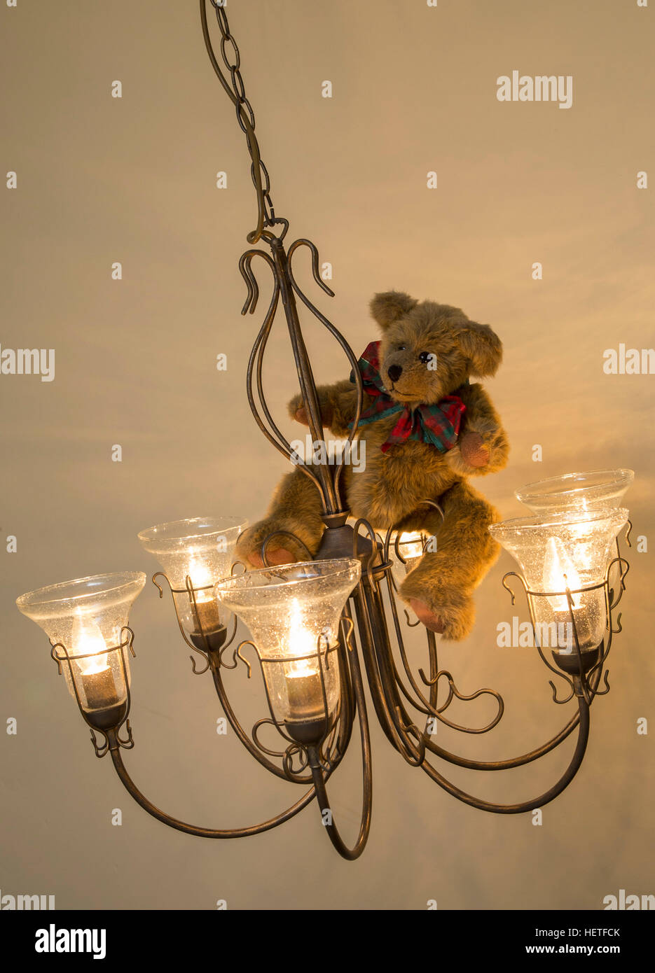 A chandelier stock photos a chandelier stock images alamy teddy bear wearing a christmas bow swinging from a chandelier stock image arubaitofo Choice Image