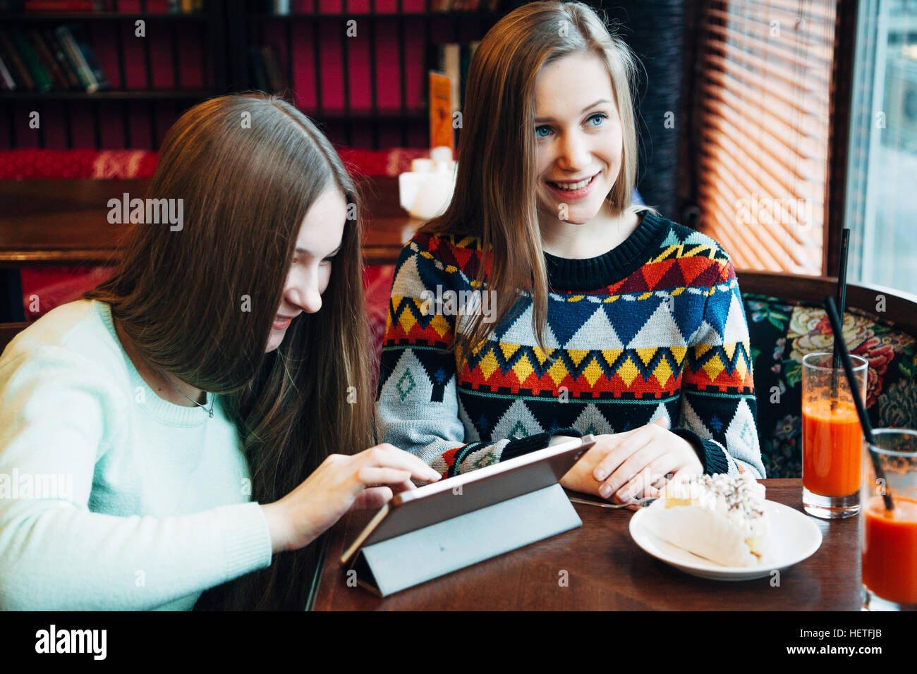 Selfie girls in cafe - Stock Image