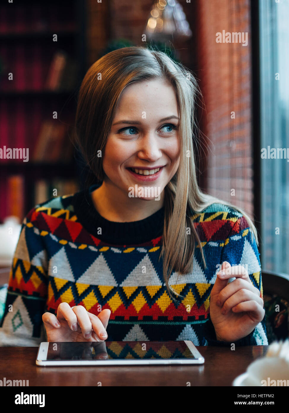 Woman in cafe smilling - Stock Image