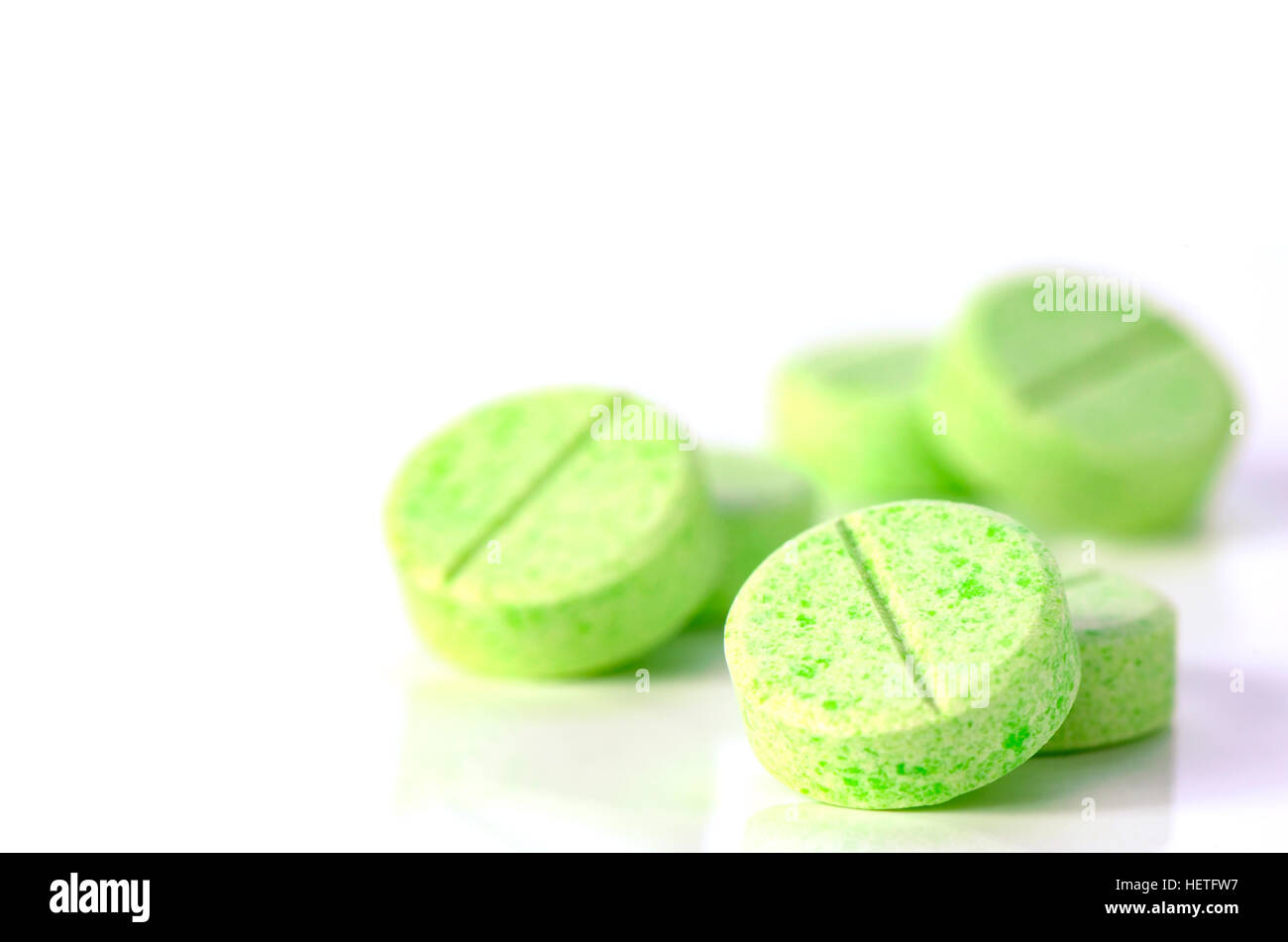 plan compress tablets with active ingredients granules insde. - Stock Image