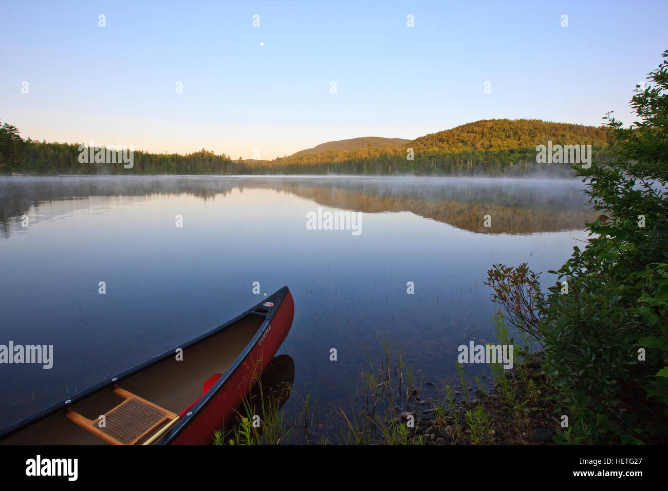 A canoe on Little Greenough Pond in Errol, New Hampshire. - Stock Image