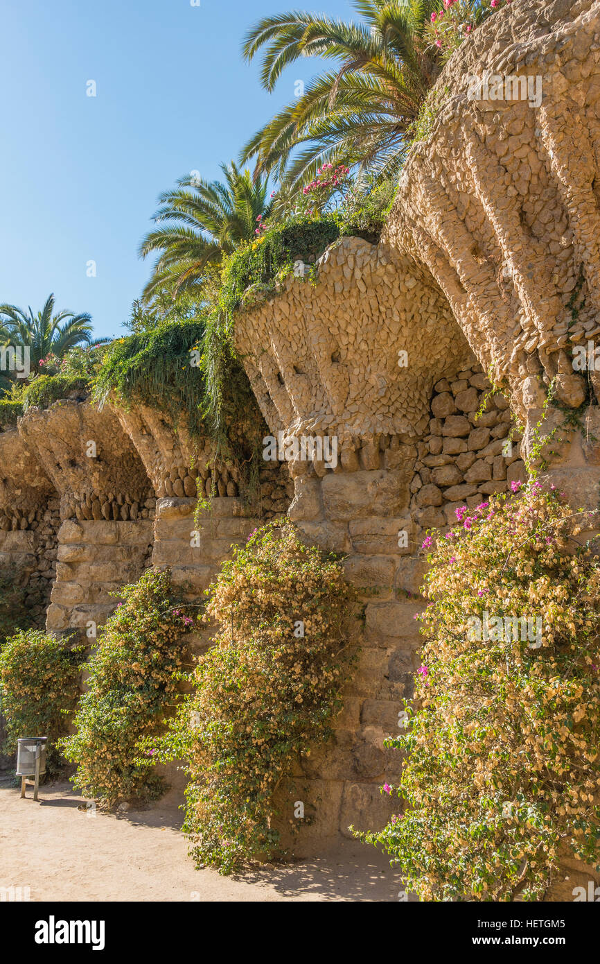 Stone pillars designed by Gaudí outside in daylight in Park Güell, Barcelona, Spain. - Stock Image