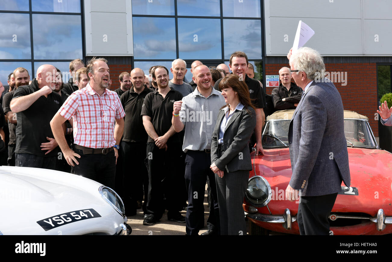 Classic Motor Cars chairman Peter Neumark handing over the company business to the employees. - Stock Image