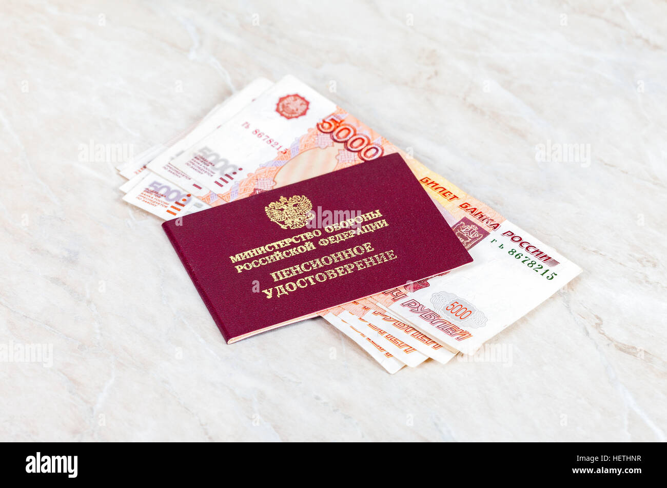 Russian Pension Certificate and money. Inscription on Certificate in russian: 'Russian Ministry of Defense', - Stock Image