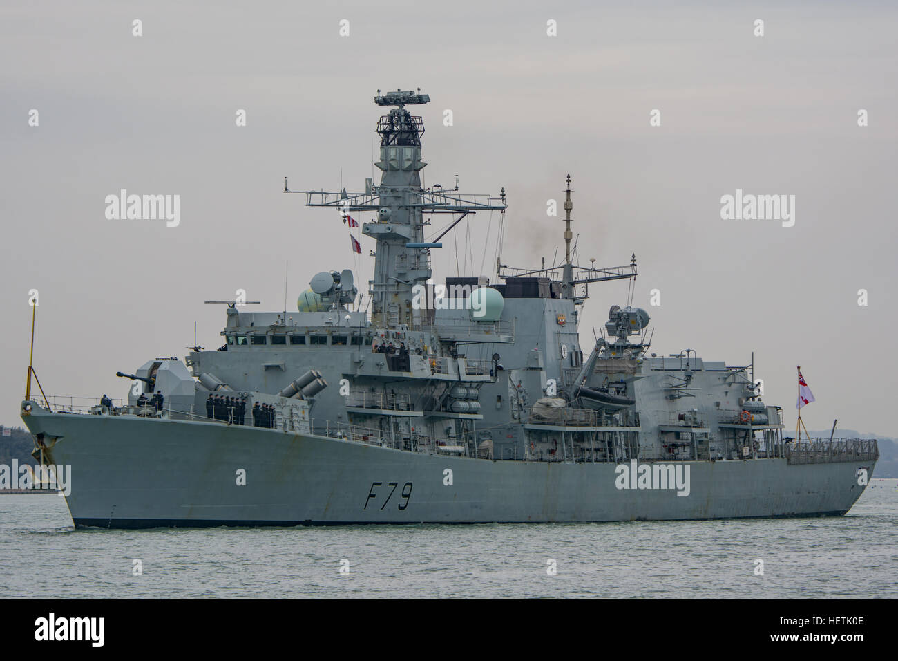 The British Royal Navy Type 23 Frigate, HMS Portland (F79) departing Portsmouth, UK on the 16th February 2015. - Stock Image