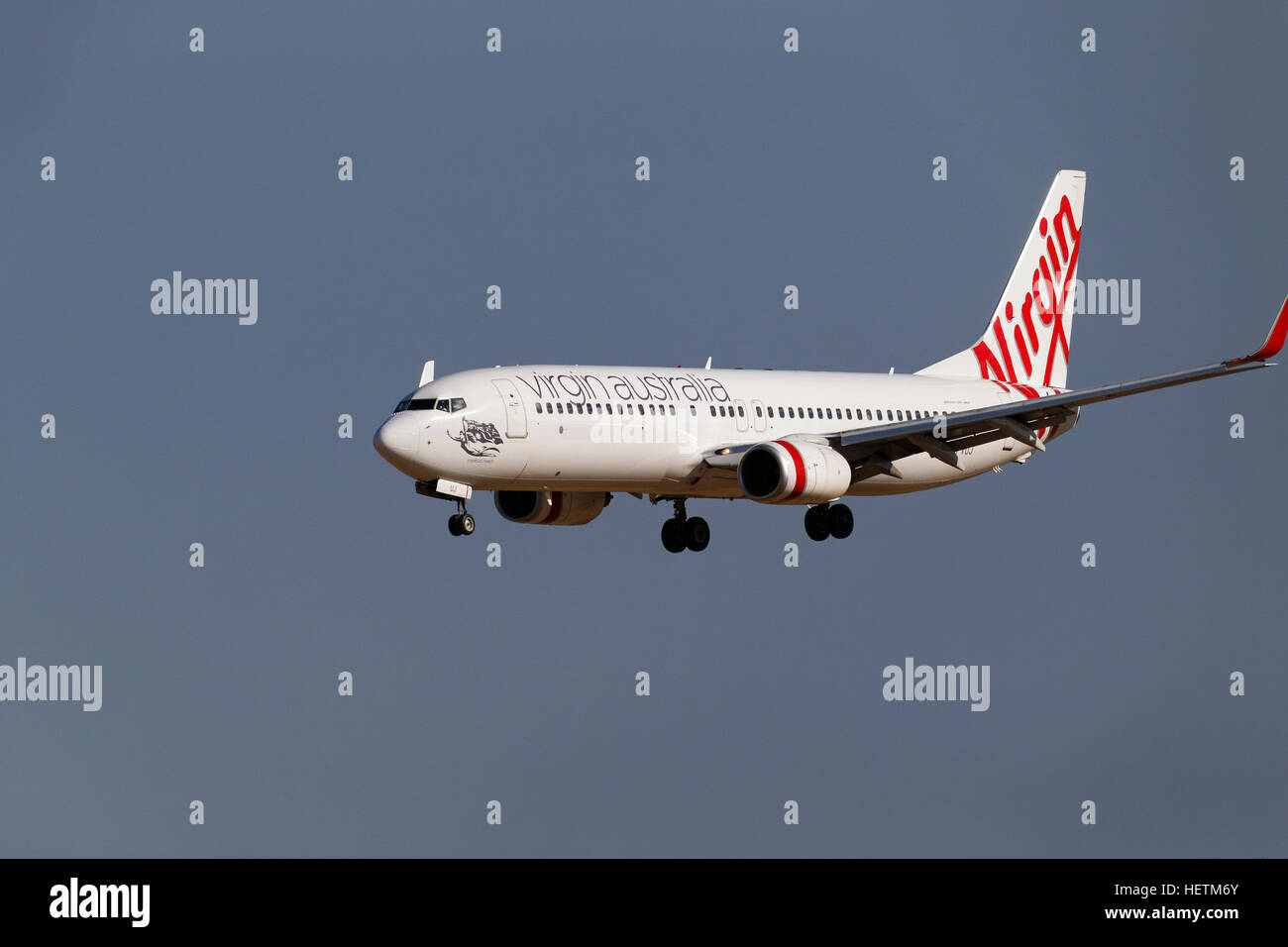 Virgin Australia airlines, commercial jet aircraft, Boeing 737-800 on approach to landing - Stock Image