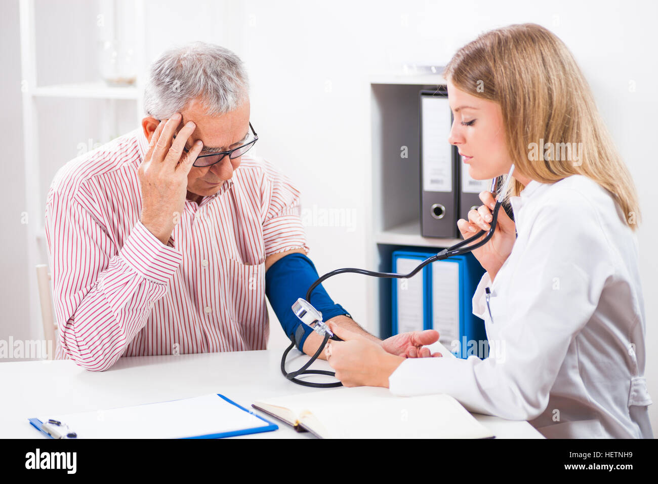 Doctor and patient in ambulance. - Stock Image