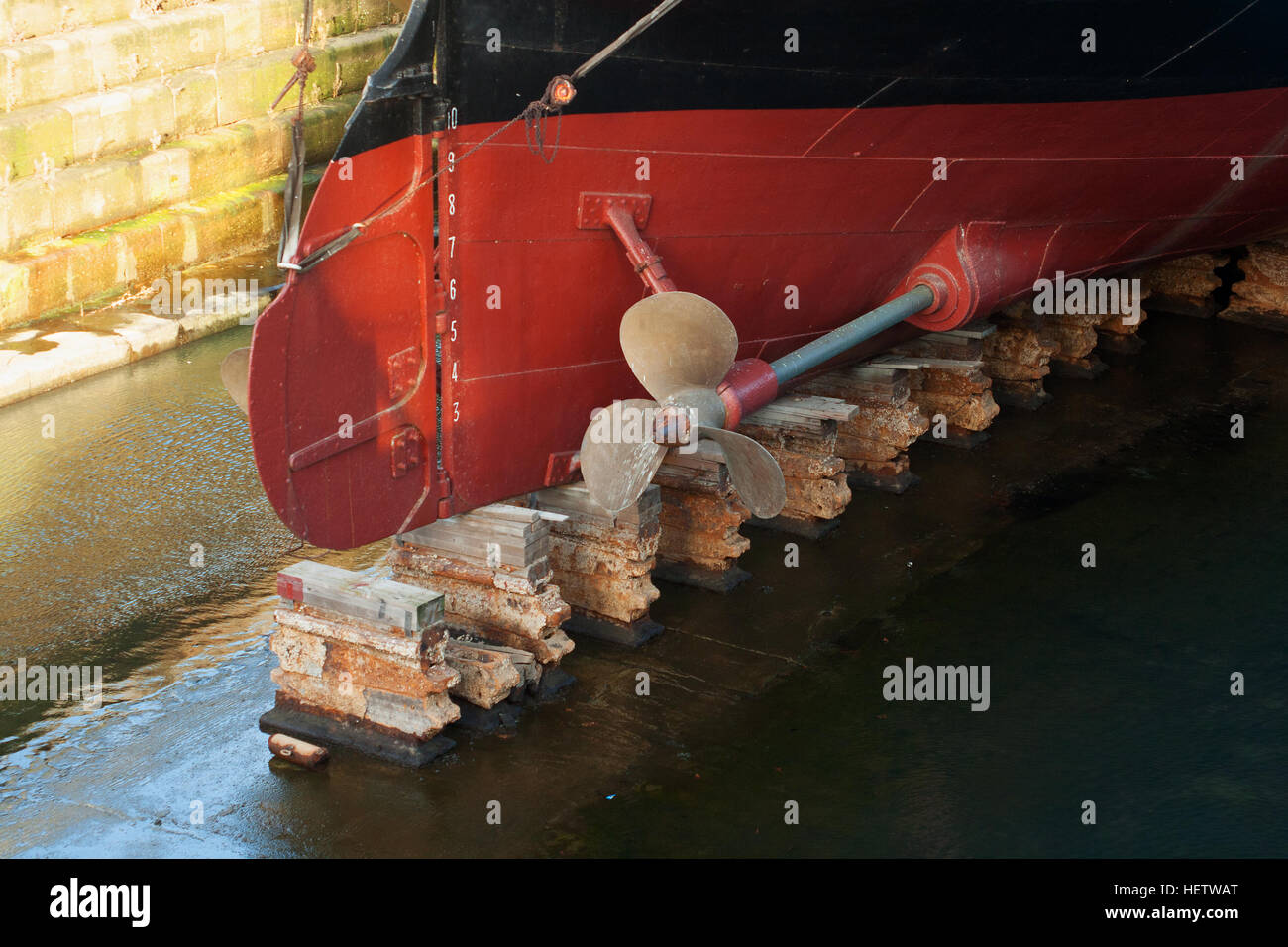 Propellers and hull of S S Nomadic, tender to the Titanic lying in Hamilton Dock, Belfast home of Titanic with the - Stock Image