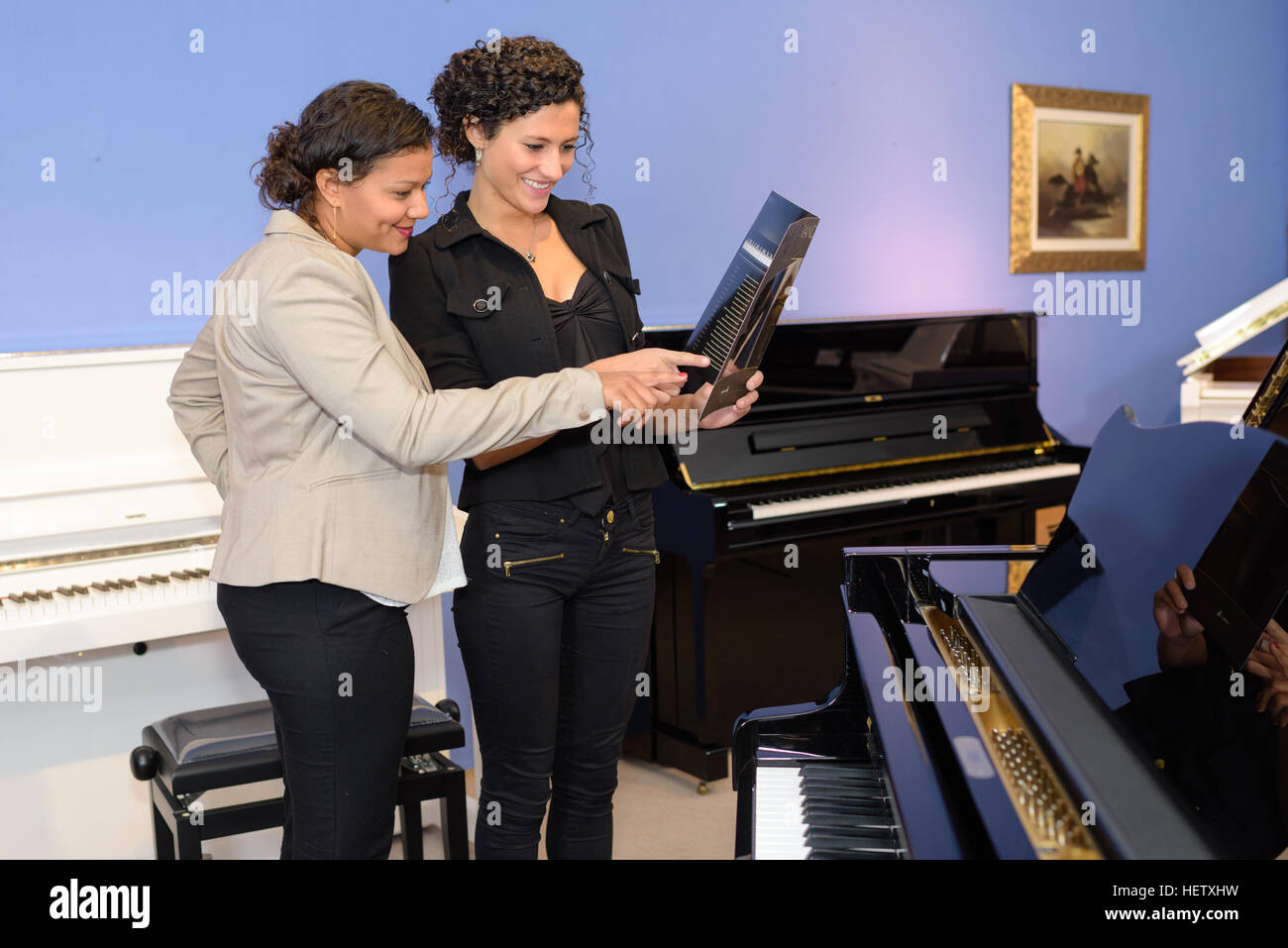 in the piano shop - Stock Image