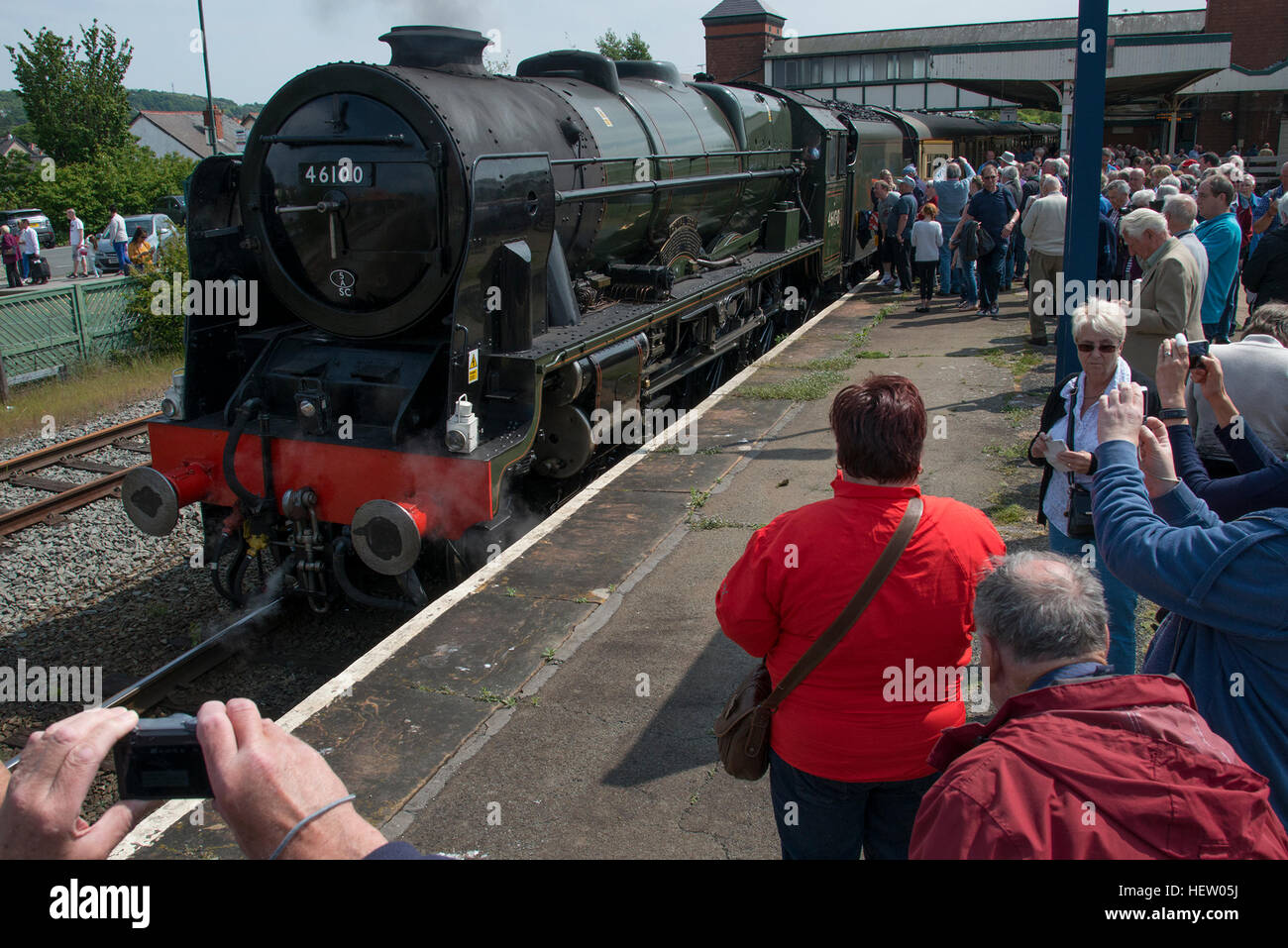 Royal Scot steam locomotive at station platform with crowd on onlookers - Stock Image