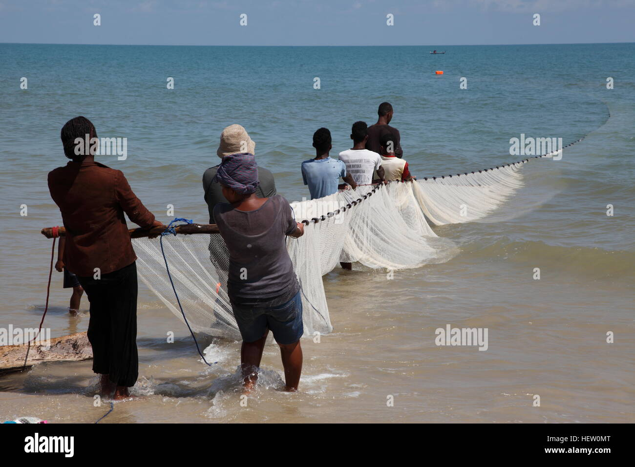 Hauling in the fishing net on the beach at Morondava - Stock Image