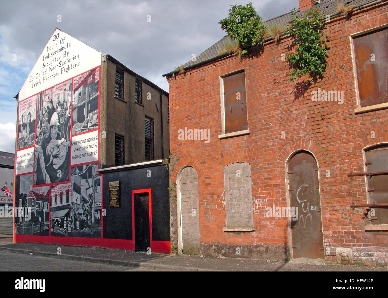 Shankill Road Mural -thirty years of slaughter, West Belfast, Northern Ireland, UK - Stock Image