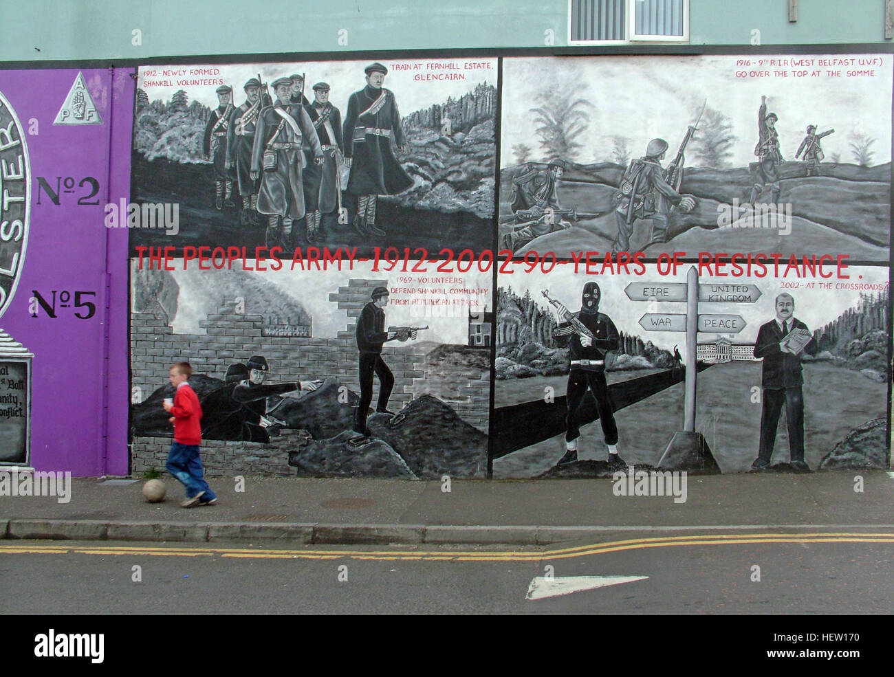 Shankill Road Mural -90 years of resistance, West Belfast, Northern Ireland, UK, with boy kicking football Stock Photo